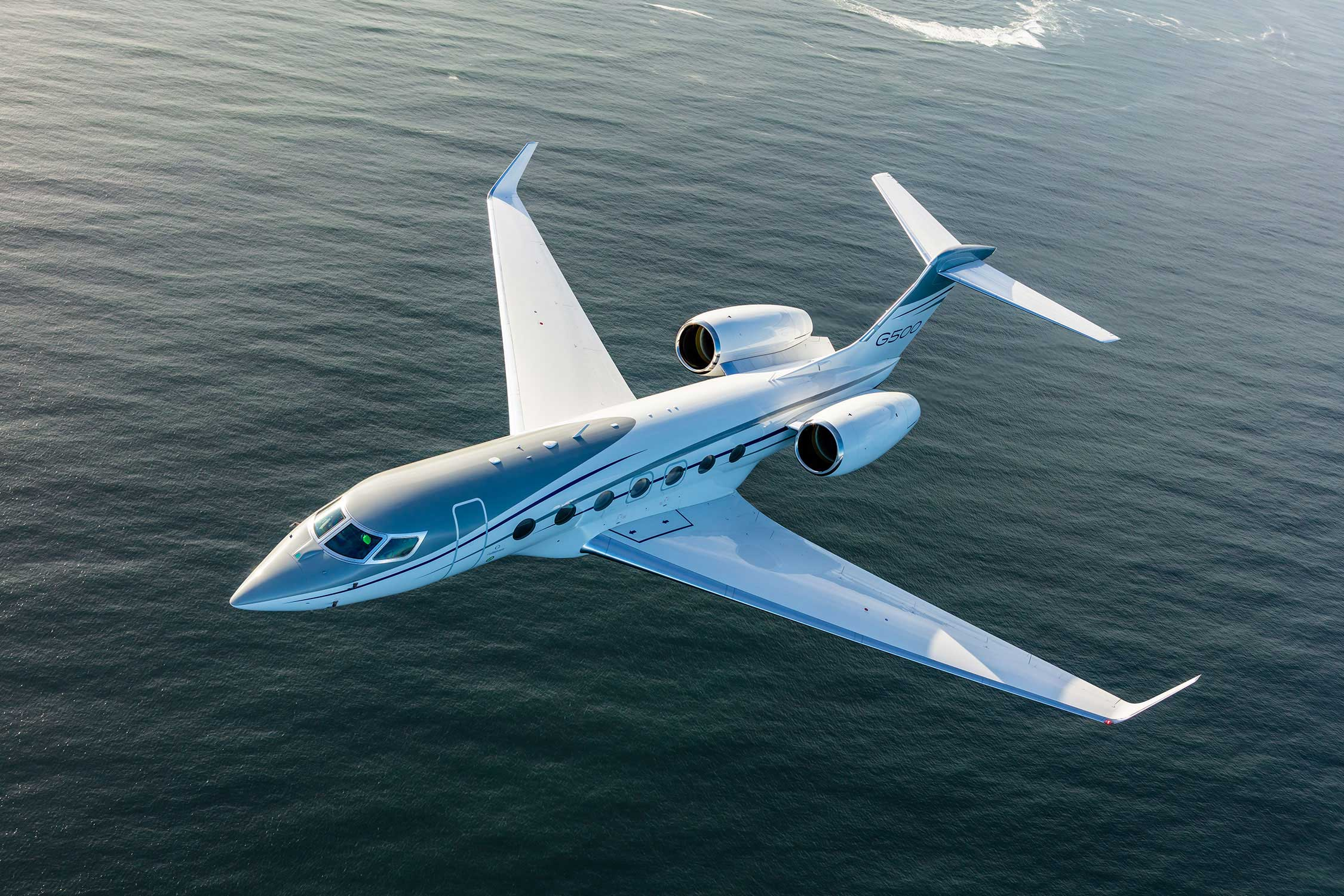 G500 aircraft flying above the ocean