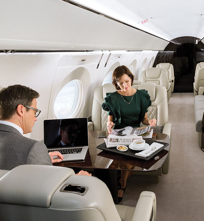 Man and woman inside business aircraft