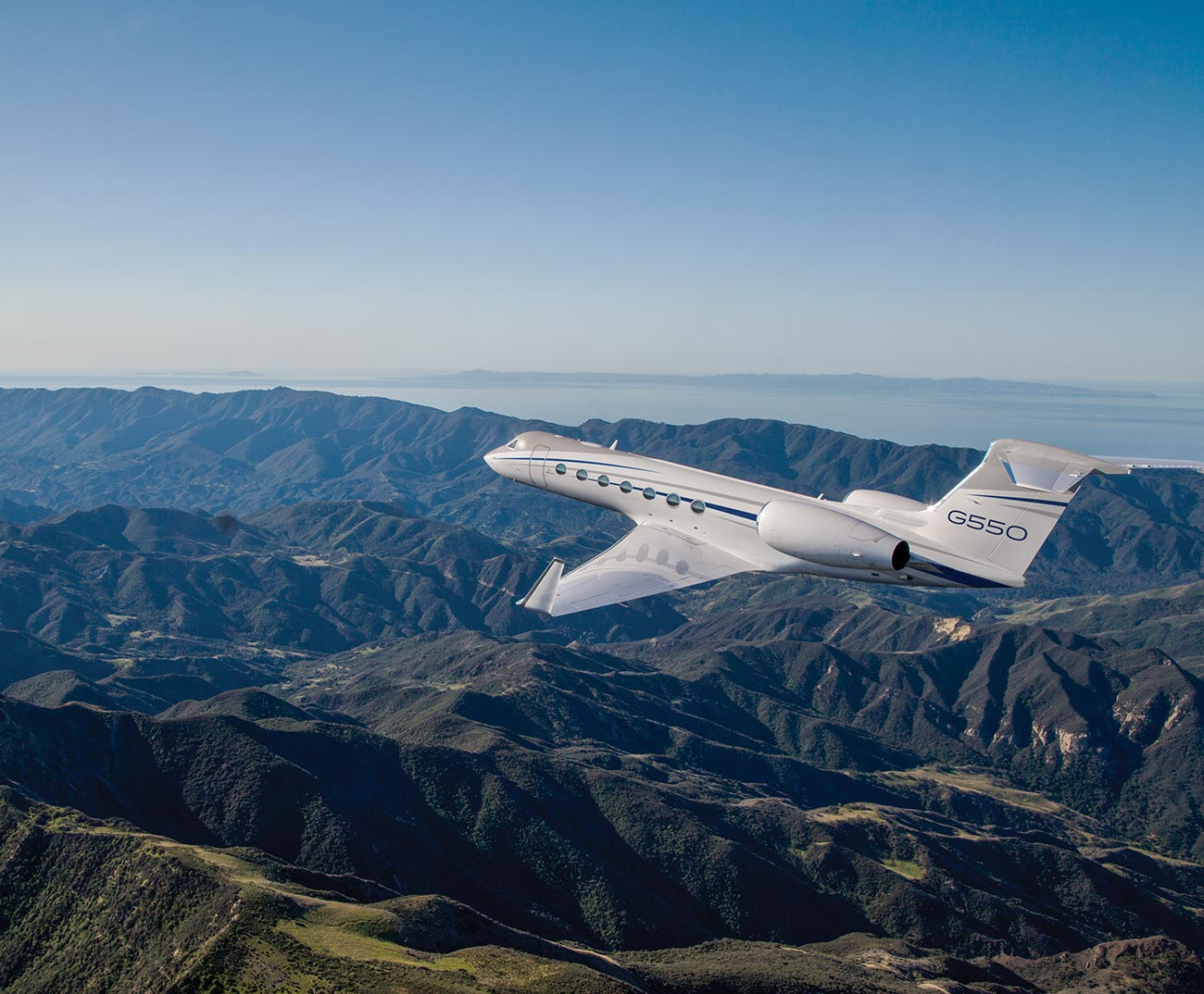 G550 flying over bumpy mountains