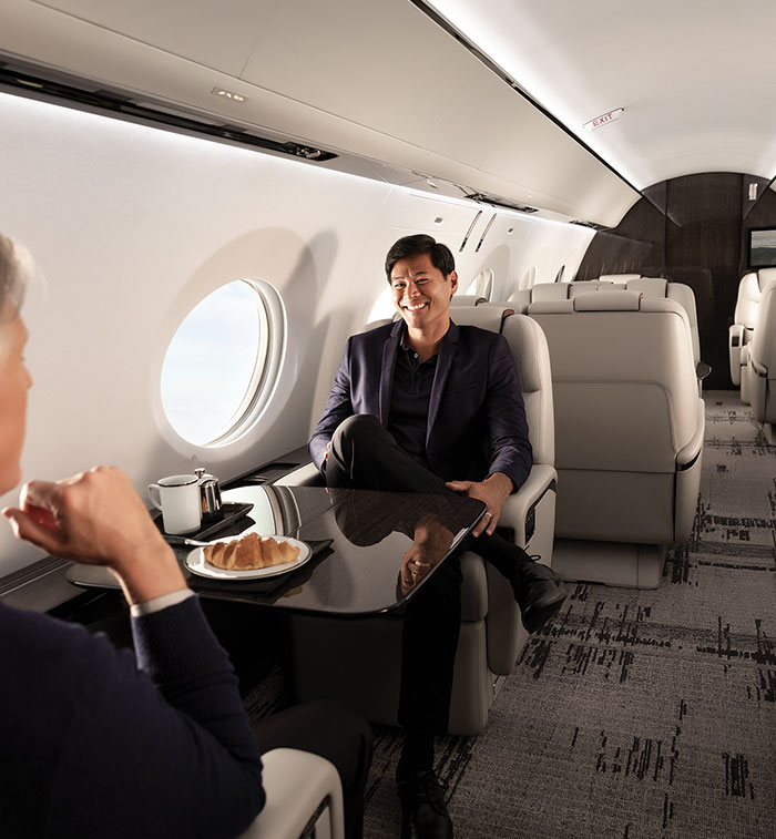 Businessmen seated inside aircraft