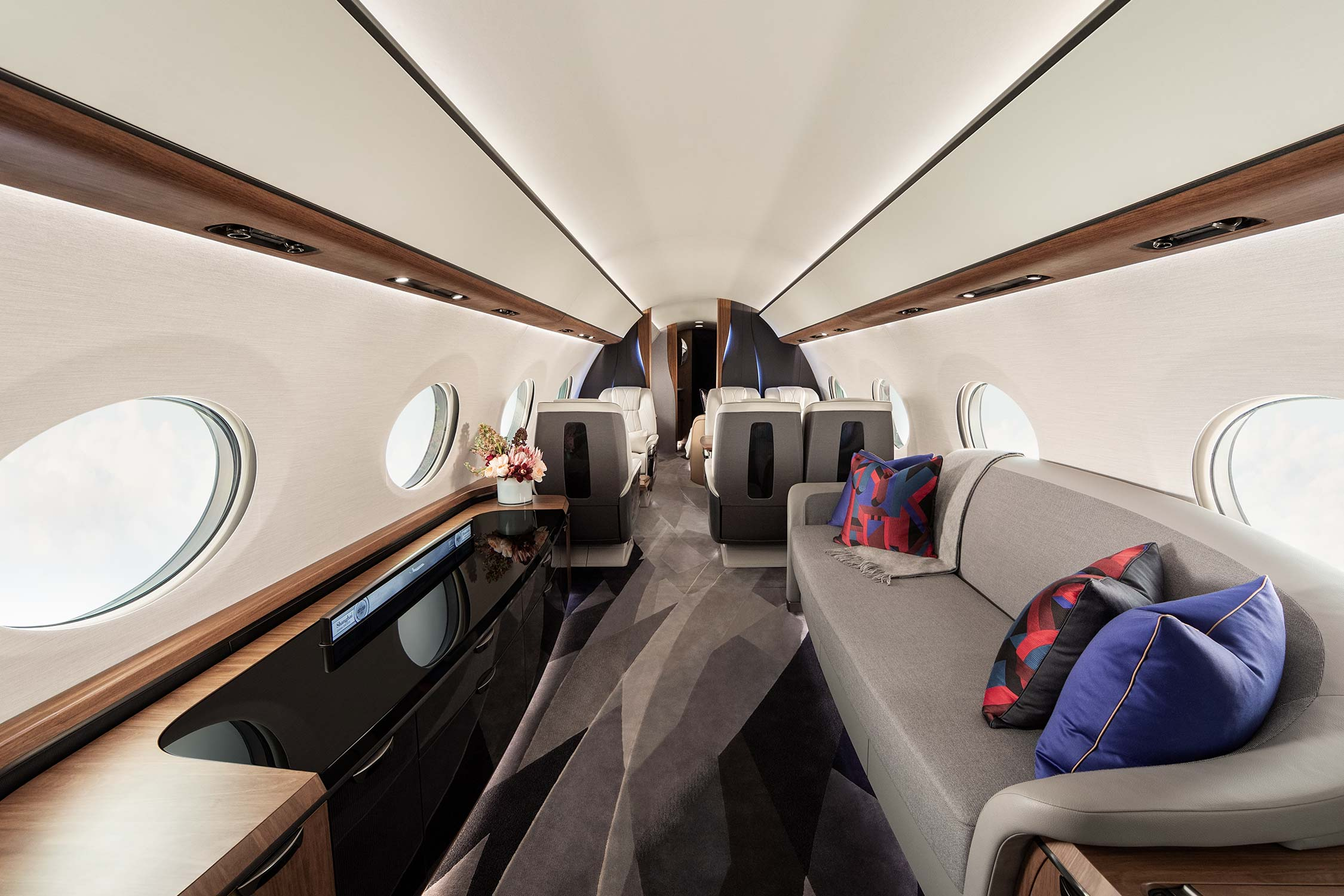 Divan with pillows in a private airplane