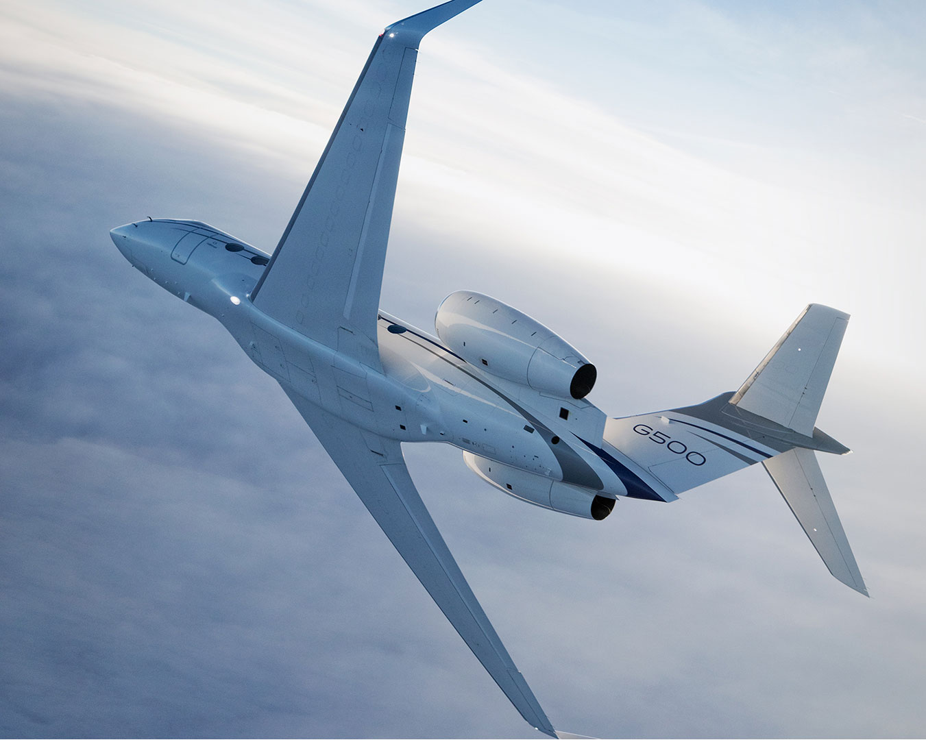 G500 aircraft banking right above the clouds