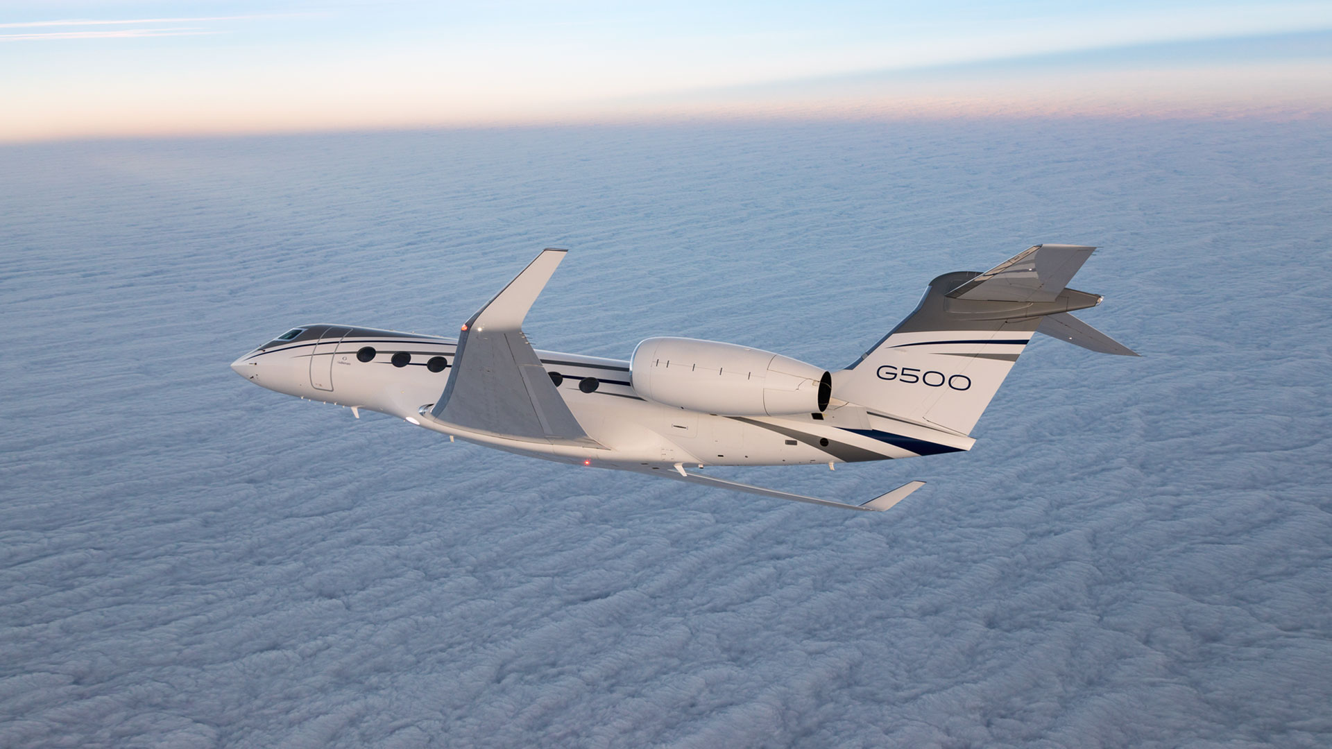 G500 flying over clouded sky.