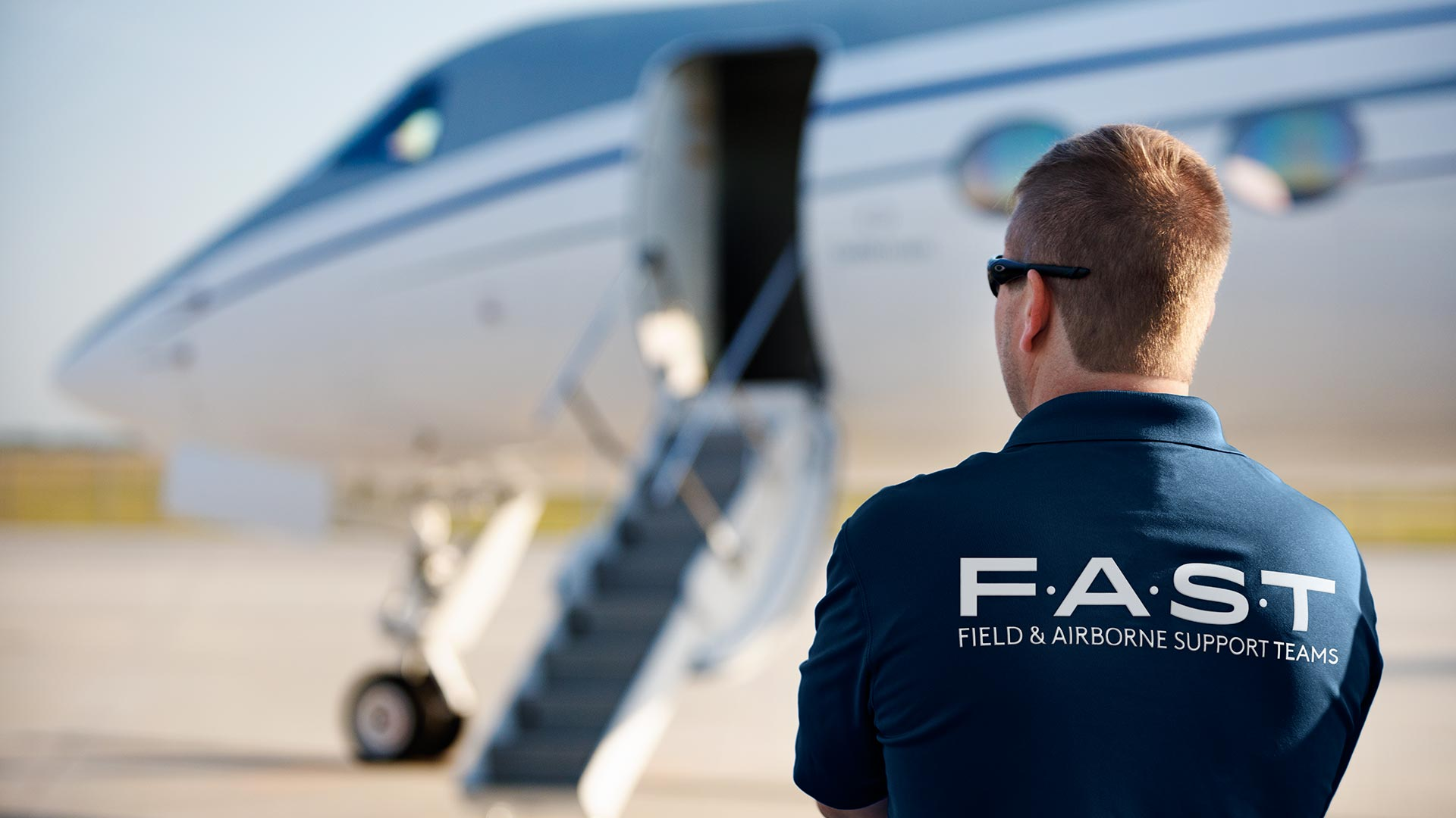 Gulfstream FAST technician overlooking the runway.