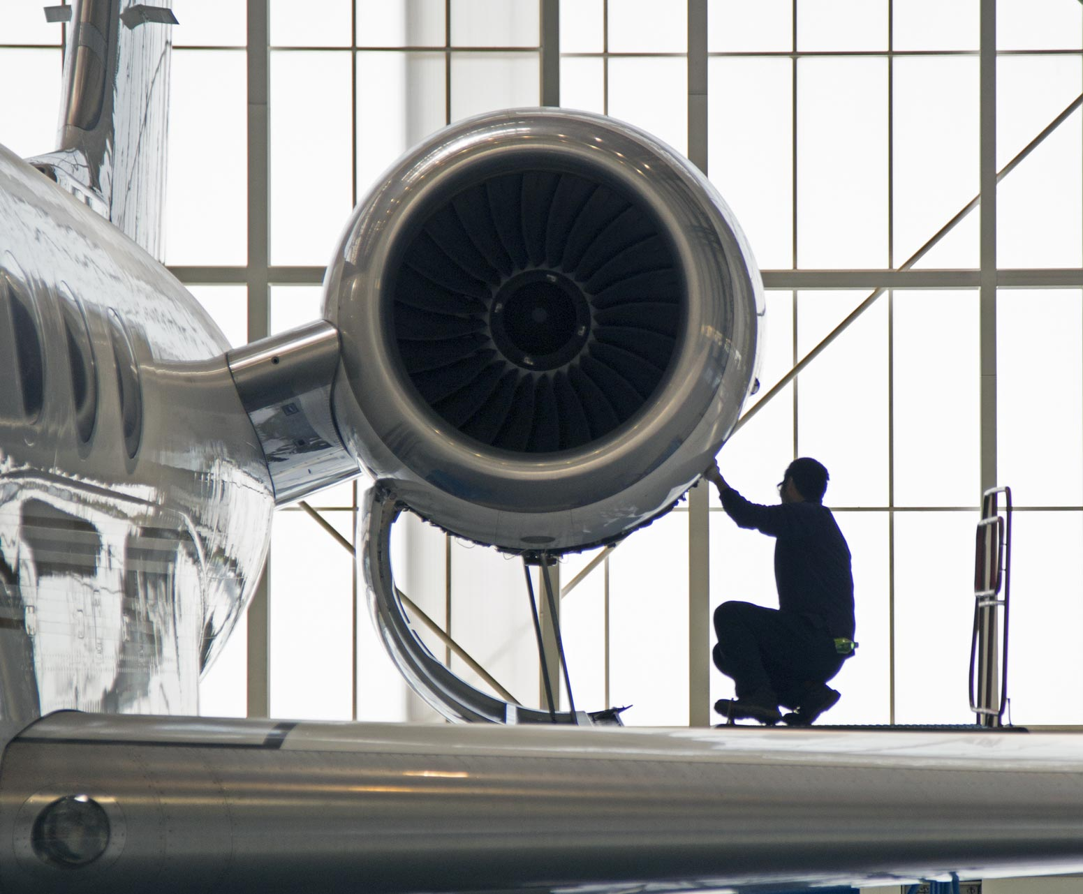 Aircraft technician working on a plane engine